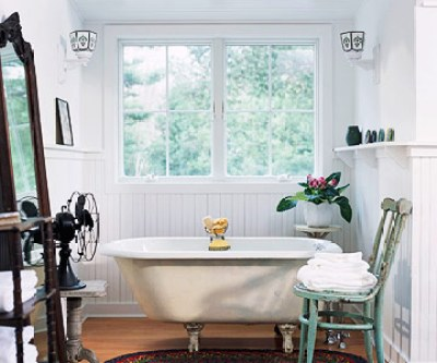 Clawfoot bathtub and vintage fan.