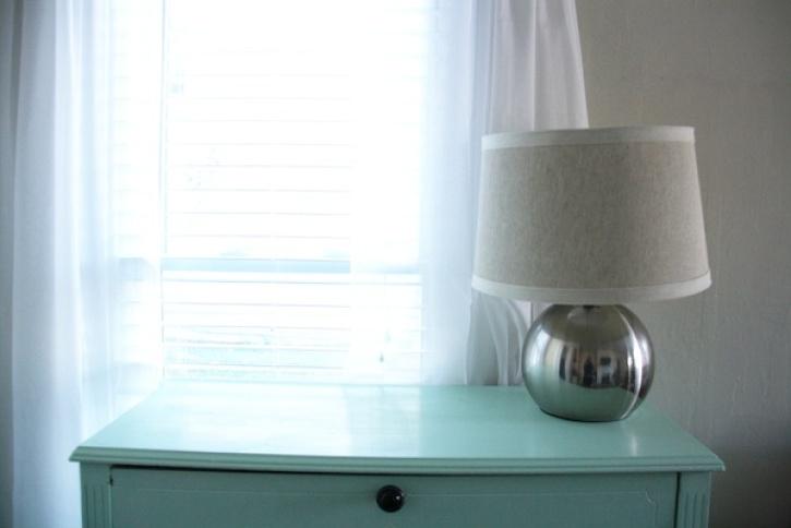 Lamp on blue dresser.