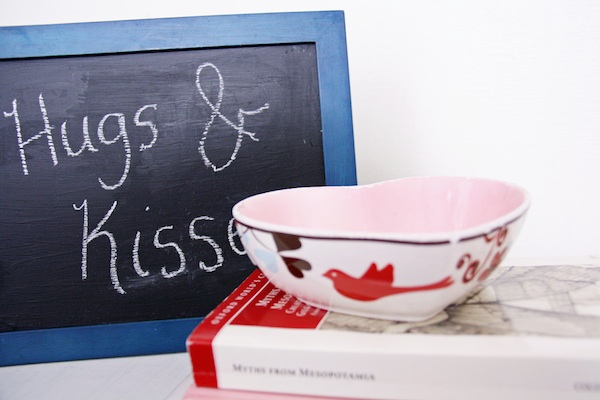 "Chalkboard with ""Hugs & Kisses"" written on it 