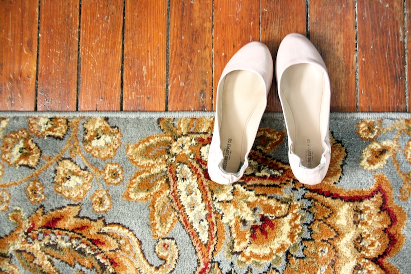 Shoes on blue rug.