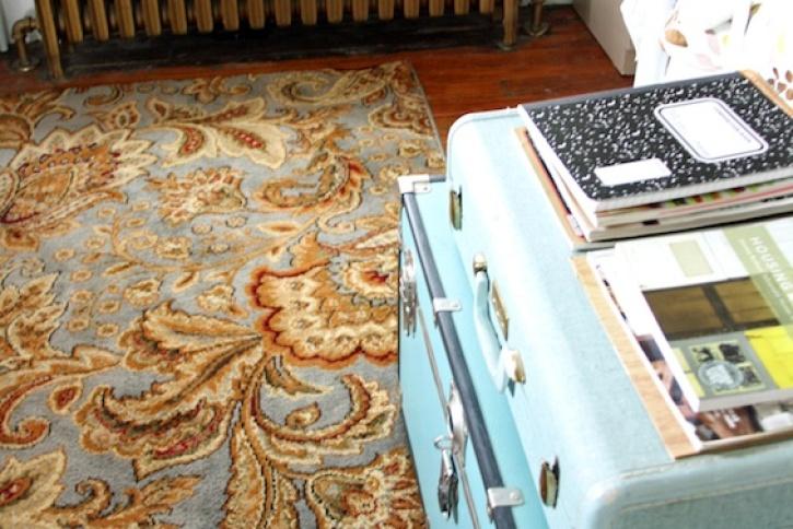 Bedroom rug and radiator.